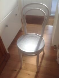 Single white wooden chair.