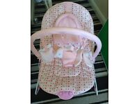 Baby's pink vibrating and musical bouncer