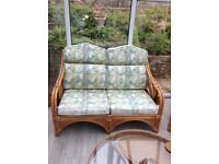 Cane 2-seater settee and 2 chairs with matching coffee table