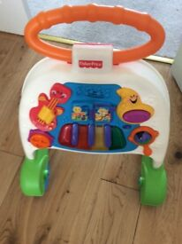 Fisher Price baby walker with piano on front
