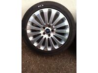 Set Four Alloy Wheels and Tyres for Ford incl centres, nuts and locking nuts