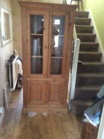 Glass fronted cabinet with cupboards - hand made waxed pine. Approx 6'6 tall.