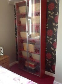 Beautiful red display cupboard with glass doors
