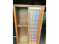 Glass fronted storage cupboard