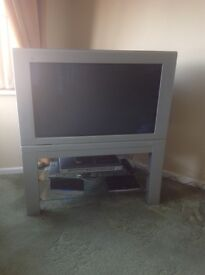 Philips 34 inch TV set with 2 glass shelves and a Philips DVD player all with remote controls