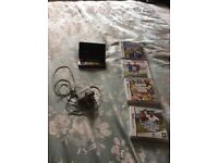 Nintendo 3ds black console with charger and 4 games