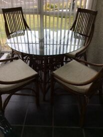 Conservatory glass topped table with 4 chairs