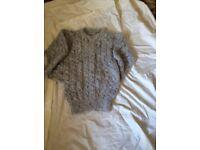 Ladies hand knitted Aran jumpers and Aran cardigan