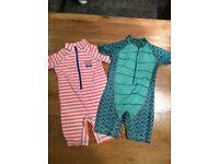 Two Next branded sun protection swim suits aged 3-4 years.
