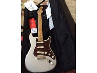 American fender strat. Couple of years old never been used in perfect condition.