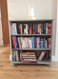 Grey bookcase with 2 shelves.