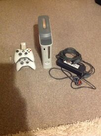 Xbox 360 console with 2 controls and 15 games