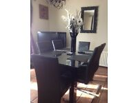 Glass table and six chairs with black legs very popular now