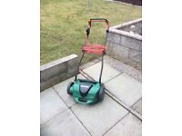 Qualcast lawn scarifier.
