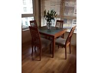 Expandable glass top dining table & chairs