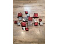 Red and silver metal wall art