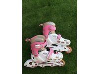Pink/white in-line roller skates. Adjustable size from 12J-2
