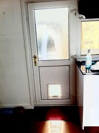 White PVC Double Glazed External Door with Dog Flap in Excellent condition
