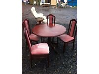 Sterling furniture mahogany extending dining table & four upholstered chairs