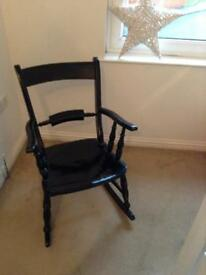 Attractive old solid wood rocking chair