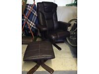 Faux leather recliner and footstool.