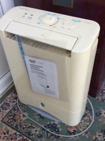 Dehumidifier with instruction leaflet