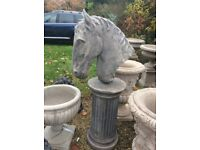 Horses head on plinth