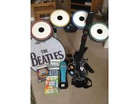 Xbox 360 drum kit, guitar, Beatles accessories and 4 games.