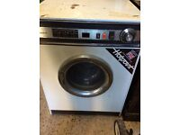 Old clothes dryer in working condition rusty on top