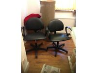 Two black Salon cutting chairs