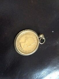 Half sovereign pendant in mount it's 10 grams in weight 9 carat gold great condition