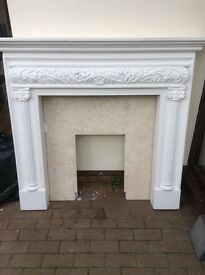 Fireplace /surround. White plastercast fireplace and marble inset.