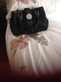 DKNY black handbag as new with shoulder strap or handles