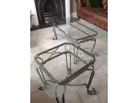 Set of glass-top decorative living room tables.