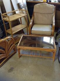 Furniture for a conservatory. In cane, two chairs, table and book stand