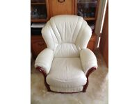 Comfortable cream armchair with wooden detail- Italian make in good condition.