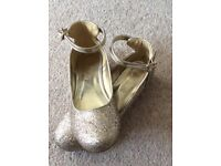 Marks and Spencer's Sparkly gold girls shoes size 3.