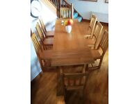 Solid Oak Dining Table with Eight Chairs