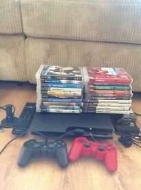 Playstation 3 250GB Slim with tonnes of extras and games including 10 singstar discs £100