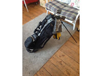 Taylor Made Golf Bag in great condition with a selection of irons - £30.