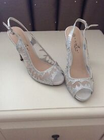 Brand new ladies sliver sling backs.
