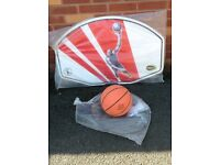 Basketball set, ball, hoop, net and wall board.