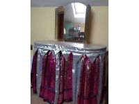 Dressing table with mirrors, and wrap around curtains covering drawers. 122 cm tall, 89 cm x 48 cm