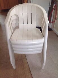 4 stackable white plastic chairs for garden, patio or general use
