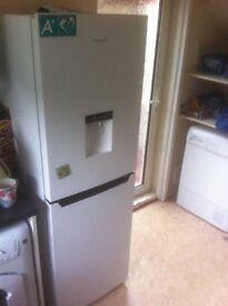 Fridge freezer with self filling water descender