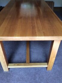 Solid Wood Dining Table with extension leaves.