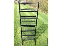 Metal shelf stand display for retail shop, has with wire trays good condition