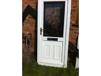 White UPVC front door with bevelled glass in good condition Height 2070 mm Width 910 mm