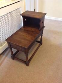 Solid oak telephone seat with storage under seat.