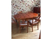 Superb quality yew wood dining table and chairs